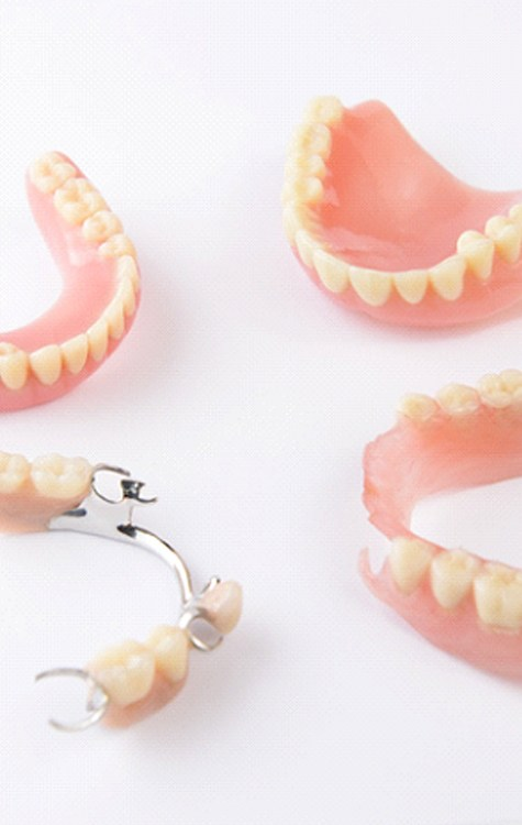 Dentist checking the smile of a man with dentures