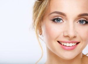 young woman smiling perfect teeth