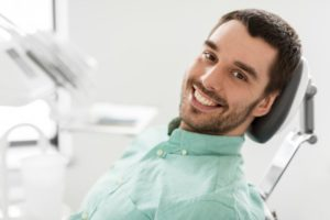 Man smiling after dental examination.